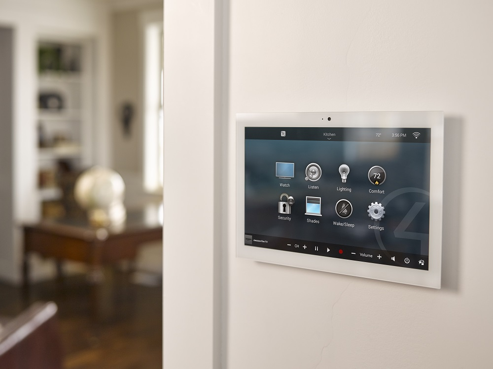 Smart_Home_Security_Control4_In_Wall_Touch_Screen_White_Wall_Hallway_Looking_At_Living_Room